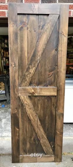 Bi-fold barn door