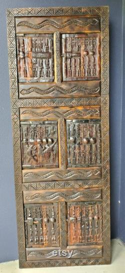 Unique Dogon antique african door one of a kind old wooden panel great for wall decor featuring african village warriors army dogon pride