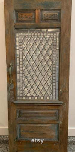 Vintage door with leaded glass and seahorse handle