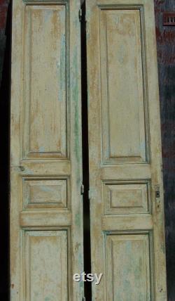 antique mediterranean tall wood doors,raised panels,chippy sea green,mustard paint,two panel door,tall wood doors,old heavy doors,wall art