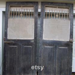 antique mediterranean wood doors with iron panels,salvage european doors,gray black doors,architectural,carved wood door,tall heavy doors